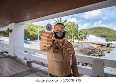Chonburi, Thailand - May 26, 2020 : People using infrared thermometer to measure body temperature for Coronavirus (CoVID-19) flu patient with high temperature fever in check point area.