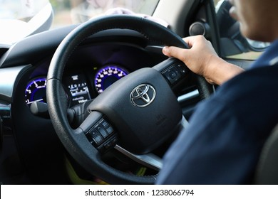 Chonburi, Thailand - November 18 2018 : Toyota steering wheel with driver's hands hold it.