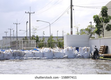 CHONBURI THAILAND - Oct 18,2013  : Sand bag infront of factory. Water flooding attack to Amata Nakorn Industrial Estate in Chonburi Thailand.