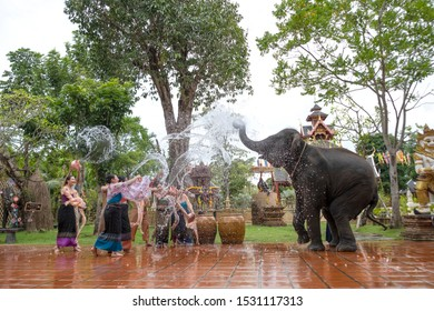 CHONBURI/ THAILAND - September 14, 2019: imitated Water splashing festival or Songkran festival, famous summer event in Thailand with an elephant and people wearing  northern style clothe