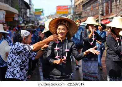 CHONBURI, THAILAND-2017, 13 APRIL : Songkran festival on 13 april, people so happy playing fresh water. Songkran parade of Thai dance. The Thai New Year's Day is 13 April every year. Selective focus.