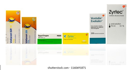 CHONBURI, THAILAND-AUGUST 3, 2018 : Voltaren SR 75 mg, Voltaren 25, Reparil-Dragees, Zyrtec film-coated tablets, Ventolin Evohaler and Zyrtec oral solution isolated on white background. Drug packaging