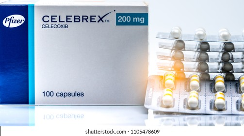 CHONBURI, THAILAND-JUNE 2, 2018 : Celebrex 200 mg capsules. Celecoxib product of Pfizer Pharmaceuticals in Thailand. Painkiller medicine. White opaque body with gold ink band capsule pills. NSAIDs.
