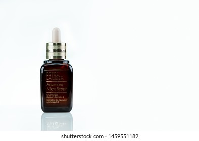CHONBURI, THAILAND-MAY 8, 2019 : Estee Lauder Advanced Night Repair Synchronized Recovery Complex II. Facial serum bottle isolated on white background. Brown glass bottle with dropper. Skincare bottle