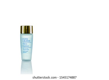 CHONBURI, THAILAND-MAY 8, 2019 : Estee Lauder Micro Essence. Skin activating treatment lotion. Facial lotion bottle isolated on white background. White glass bottle. Skincare bottle with copy space.