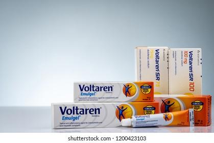 CHONBURI, THAILAND-OCTOBER 11, 2018 : Voltaren Emulgel and Voltaren tablets. 1% diclofenac gel for topical anti-inflammatory and diclofenac sodium on white background. Painkiller, analgesic pills.