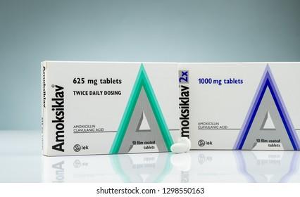CHONBURI, THAILAND-OCTOBER 14, 2018 : Amoksiklav film coated tablets. Amoxicillin and clavulanic acid. Antibiotics pills on gradient background. White antibiotic tablets pills. Antibiotics drug use.