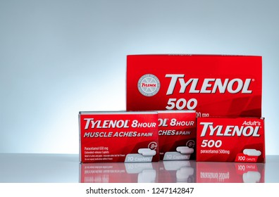 CHONBURI, THAILAND-OCTOBER 27, 2018 : Tylenol 500 mg and Tylenol 8 hour 650 extended-release caplets in red packaging on gradient background. Drug for relief pain, fever, muscle aches, and headache.