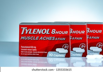 CHONBURI, THAILAND-OCTOBER 27, 2018 : Tylenol 8 hour 650 extended-release caplets in red packaging on gradient background. Drug for relief pain, fever, muscle aches, and headache. Pharmacy product.