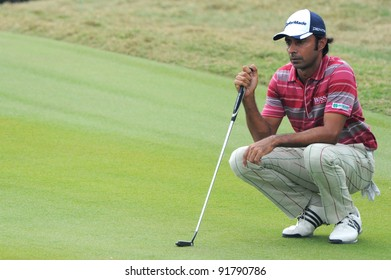 CHONBURI,THAILAND - DECEMBER 15: Jyoti Randhawa of India lines up a putt during day one of the Thailand Golf Championship at Amata Spring Country Club on December 15, 2011 in Chonburi, Thailand.