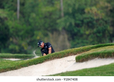 CHONBURI,THAILAND - DECEMBER 15:Prayad MARKSAENG of Thailand plays a shot during day one of the Thailand Golf Championship at Amata Spring Country Club on December 15, 2011 in Chonburi, Thailand.