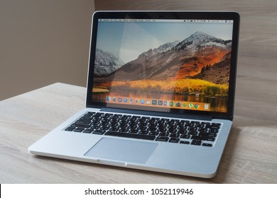 CHONBURI,THAILAND - Feb 23,2018 : Wood Office table with Macbook Pro retina 13 inch with macOS High Sierra Screen.