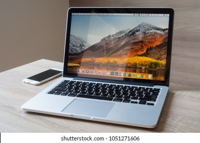 CHONBURI,THAILAND - MAR,2018 : Office table with Macbook Pro retina 13 inch with macOS High Sierra Screen, Apple iphone6, Concept of workplace at home.