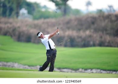 CHONBURI,THAILAND-DECEMBER 6: Tetsuji Hiratsuka of Japan plays a shot during hole 2 day one of the Thailand Golf Championship at Amata Spring Country Club on December 6,2012 in Chonburi,Thailand.