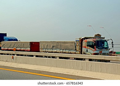 CHONBURI-THAILAND-FEBRUARY 18 : The Transportation truck on the highway   on February 18, 2016 Chonburi Province, Thailand