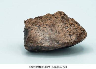Chondrite Meteorite isolated, a piece of rock formed in outer space in the early stages of Solar System as asteroids. This meteorite comes from a meteorite fall impacting the Earth at Atacama Desert