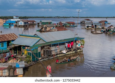 chong khneas, cambodia - november 29, 2018: chong khneas is a floating village on the tonle sap. here people live in poor conditions on houseboats.