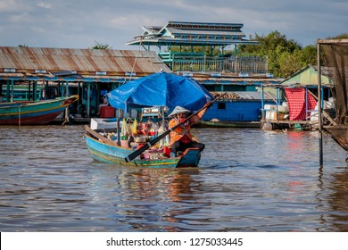 chong khneas, cambodia - november 29, 2018: chong khneas is a floating village on the tonle sap. here people live in traditional relationships on houseboats.
