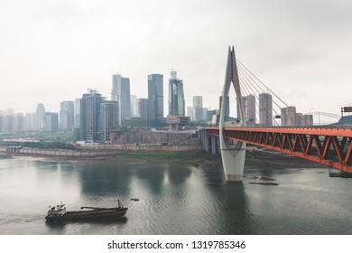 Chongqing, Chongqing / China - April 06 2015: Qianximen bridge, twin river bridges at Chongqing Jialing River