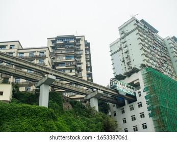Chongqing, China - January 4, 2020 : Train get into the building