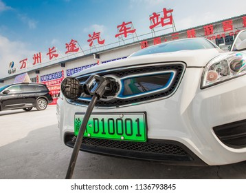 Chongqing, China - July 14, 2018: Electric vehicles are charging at the station with charging piles, in Chongqing, China