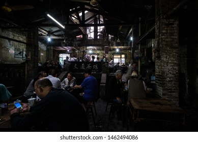 Chongqing, China - July 27, 2019: An old tea house in Chongqing, China, where middle-aged men play chess in summer