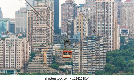 Chongqing, China - June 12, 2018 : Urban cable car transporting tourists with skyscrapers in the background