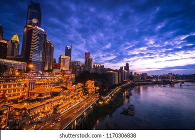 Chongqing / China - June 2018 : Hongya Cave a landmark building of Chongqing , in the period of wonderful violet twilight sky. Landscape photo.