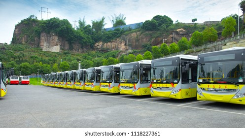 Chongqing, China - June 4, 2018: Electric parking buses parked in bulk at the parking lot. This is a hybrid car.