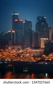 CHONGQING, CHINA – MARCH 13: Hongyadong shopping complex at night on March 13, 2018 in Chongqing. With 17M population, it is the most populous Chinese municipality.