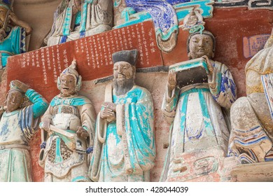 CHONGQING, CHINA - MARCH 4, 2016 : Rock carving series of Chinese religious sculptures depicting and influenced by Buddhist, Confucian and Taoist beliefs.