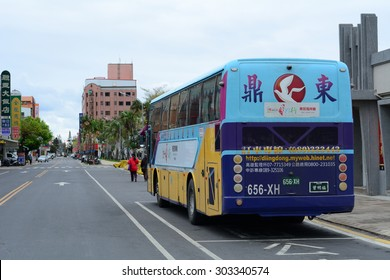 CHONGQING, CHINA - NOV 4, 2014: A public bus on the street in Chongqing, China. Start price is CNY 1 for common buses and CNY 1.5 for air-conditioned buses. Running hour buses is 5:30 to 21:00.