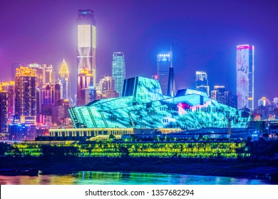 CHONGQING, CHINA - SEPTEMBER 23: View of the Chongqing Grand Theatre building and city skyline at night on September 23, 2018 in Chongqing