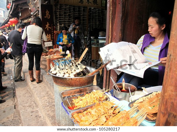 CHONGQING - MARCH 19: A street food vendor on March 19, 2012 in Chongqing. According to the Food and Agriculture Organization, 2.5 billion people eat street food every day.