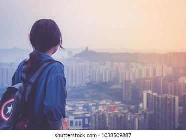 CHONGQING,CHINA 19 june 2018 - the girl looks Chongqing city view at Eling peak mountain