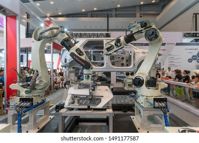 Chongqing,China-August,29th 2019:Robot arm assemble car display in Smart China expo. China is developing its technology in robot industry and applicate in car industry.
