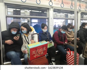 chongqing,china-Jan,23th 2020: chinese citizens wearing breathing mask to protect from 2019-nCoV  disease during taking subway station.