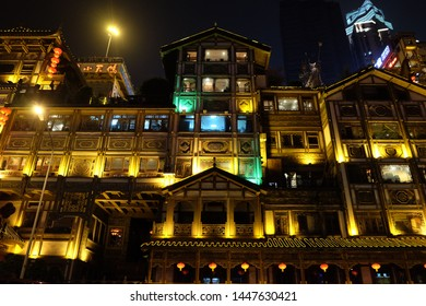 Chongqing/China-May2016: look up to buildings of Hong Ya Dong in golden lights at night. Famous tourist attraction for its houses similar with scenes of Japanese cartoon Spirited Away
