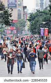 CHONGQING-NOVEMBER 4, 2014. Crowd in a shopping area. As of 2010 census the municipality had a population of 28,846,170 According to this census, Chongqing is the most populous Chinese municipality.