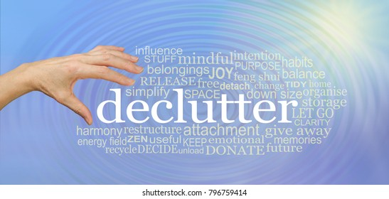 Choose to declutter your life and feel the effect - female hand about to pick up the word DECLUTTER surrounded by a relevant tag word cloud on a water ripple effect blue background