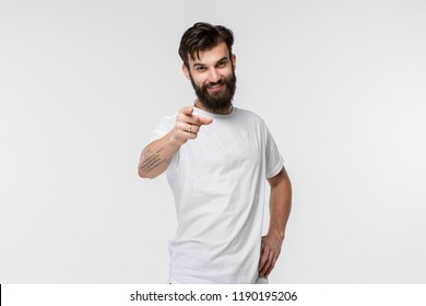 I choose you and order. The smiling business man point you, want you, half length closeup portrait on studio background. The human emotions, facial expression concept. Front view.