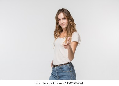 I choose you and order. The smiling business woman point you, want you, half length closeup portrait on white studio background. The human emotions, facial expression concept. Front view. Trendy