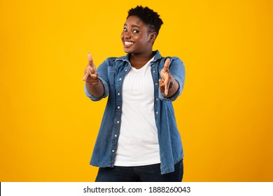 I Choose You. Smiling Plus-Size African Woman Pointing Fingers At Camera Posing Standing Over Yellow Background In Studio. Positive Black Lady Gesturing You're Next Concept