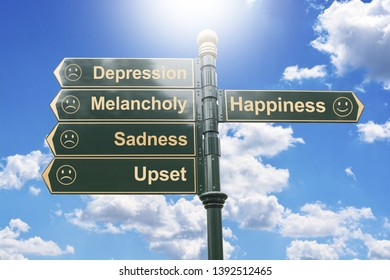 Choose your way to happiness or to depression and sadness with road arrows against blue sky