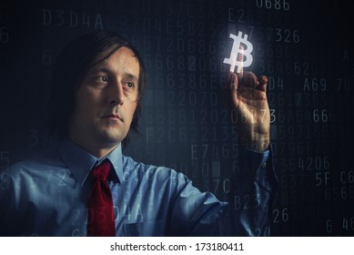 Choosing bitcoins as currency, businessman pressing touch screen button.