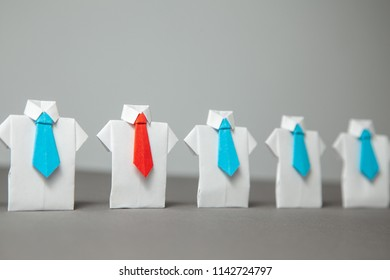 Choosing good employee leader. Staff recruitment. Pretenders in white shirt and blue ties, elected leader in red tie