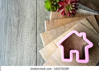 Choosing home floor between wooden ceramic tiles and luxury vinyl wood pattern for new home interior design