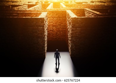 Choosing a successful business strategy for solving a complex problem concept, man in front of the huge brick maze, 3d illustration