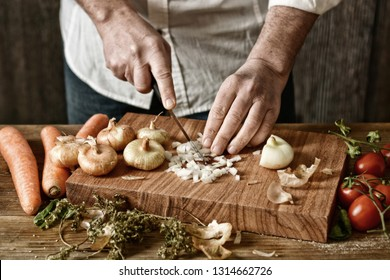 chop onion on wooden chopping board - healthy and traditional eating - desaturated effect - selective focus - closeup