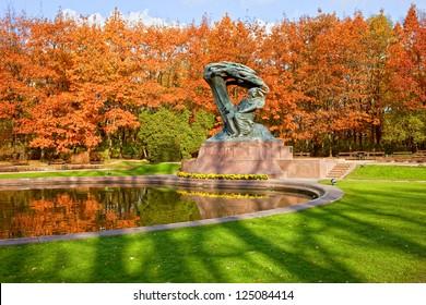 Chopin statue in autumn at Royal Baths Park (Lazienki Park) in Warsaw, Poland, designed around 1904 by Waclaw Szymanowski (1859-1930).